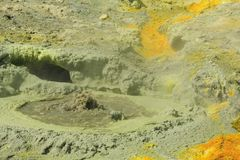 A bubbling volcanic mud pool on White Island, NZ royalty free stock photo