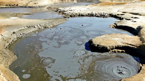 Boiling mud pool stock footage