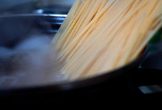Boiling pasta. Cooking spaghetti in water for pasta Royalty Free Stock Photography