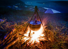 Boiling pot at the campfire on picnic after sunset. Stock Image