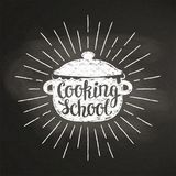 Boiling pot chalk silhoutte with sun rays and lettering - Cooking school - on blackboard. royalty free stock photography