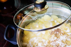 Boiling potatoes Stock Photography