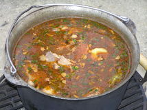 Boiling soup in the cauldron Stock Photo