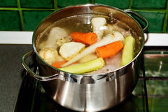 Boiling soup in the pot Royalty Free Stock Image