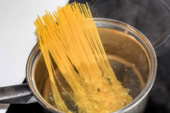 Boiling spaghetti noodles in the pot Stock Images