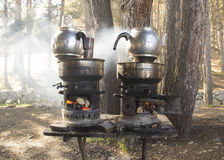 Boiling tea at outdoors Stock Images