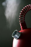 Boiling teapot. Red boiling teapot on a dark background Royalty Free Stock Photo