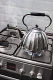 Boiling teapot Stock Photos