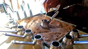 Boiling turkish coffee on the sand. Roadside cafe in bedouin village offers hot, tasty, strong coffee, boiling in cezve on the sand, Sinai, Egypt stock video footage