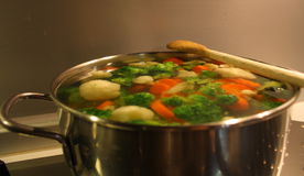 Boiling vegetables stock photos