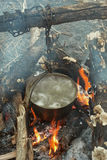 Boiling water in the bowler on the bonfire.  stock images