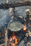 Boiling water in the bowler on the bonfire.  royalty free stock photo