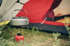 Boiling water in kettle on portable camping stove Royalty Free Stock Photography