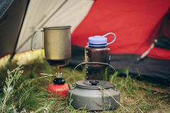 Boiling water in kettle on portable camping stove Stock Images