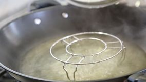 Boiling water stock video footage