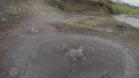 Boiling water in natural volcanic hot springs stock video