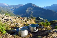 Big aluminum cooking pots surrounded in an amazing natural setting, Num, Nepal stock photography