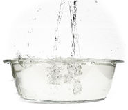 Boiling water in an ovenproof dish. On clear white background Royalty Free Stock Photography