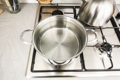 Boiling water in a pot. A metal pot on the stove with boiling water to cook spaghetti royalty free stock image