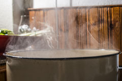 Boiling water in a saucepan Royalty Free Stock Image
