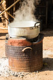 Boiling water in traditional pot on charcoal stove Stock Photography