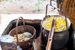 Boiling White and Yellow silkworm cocoons in the pot to make Silk Thread, Boil Silk Nest with Silk Reeling. In Thailand stock photo