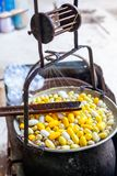 Boiling White and Yellow silkworm cocoons in the pot to make Silk Thread, Boil Silk Nest with Silk Reeling. In Thailand royalty free stock photo