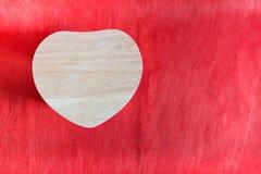 Bois de coeur sur le fond de papier rouge Photo libre de droits
