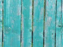 Bois peint bleu vert-bleu de barrière en bois vieux Images stock