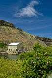 Boise Idaho irrigation diversion dam and rose bush. Boise river and Diversion dam with blue sky and cloud Stock Image