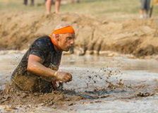 BOISE, IDAHO/USA - AUGUST 10:A man who is unidentified participates by running through the mud pit  at the The Dirty Dash in Boise Stock Photos