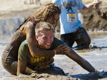 BOISE, IDAHO/USA - AUGUST 10: Unidentified couple horsing around in the mud pit near the finish at the The Dirty Dash in Boise, Id Stock Images
