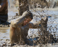 BOISE, IDAHO/USA - AUGUST 10: Unidentified man makes a splash with mud during the The Dirty Dash in Boise, Idaho on August 10, 201 Royalty Free Stock Photography