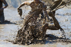 BOISE, IDAHO/USA - AUGUST 10: Unidentified person makes a huge splash in the mud. Event was held at the The Dirty Dash in Boise, I Stock Image