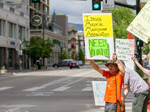 BOISE, IDAHO/USA - MAY 7, 2016: Man letting people trying to spread the word about weed Stock Photos