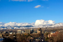 Boise With Mountains Wider Classic View. View of the Boise Skyline including the Capitol with snow in the mountains, white fluffy clouds and blue sky Royalty Free Stock Photography