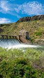 Boise River Dam in Idaho with blooming rose bush. Nature surrounds a Diversion Dam located on the Boise River in Idaho royalty free stock photos
