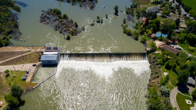 Boise River flows over a small diversion dam. Spring high water on the Boise River Idaho royalty free stock photos