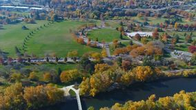 Boise River and popular city park in full fall colors. Many fall colored trees in Boise City park in autumn stock video footage