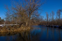 Boise River in winter with a few patches of snow. Cold clear day stock image