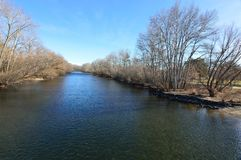 Boise River Winter Landscape. Wide angle view of the Idaho Boise River in January from Pioneer Bridge, looking upriver. Boise Greenbelt path on the right. Small stock photography