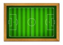 Boisko do piłki nożnej w drewnianej ramie. Obraz Stock