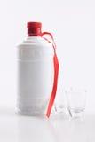 Boisson alcoolisée et cuvettes Photo stock