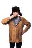 Boisson russe fâchée d'homme une vodka Photographie stock