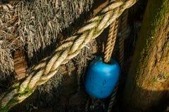 Boj som hänger av en pir Fotografering för Bildbyråer