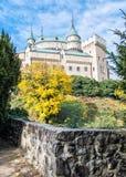 Bojnice castle in Slovak republic, autumn scene. Bojnice castle in Slovak republic. Yellow autumn trees. Cultural heritage. Seasonal scene. Vibrant colors stock photos