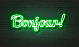 Bojour neon sign on brick wall background. Stock Images