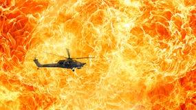 Bojowy helikopter na ognistym tle Zdjęcia Royalty Free