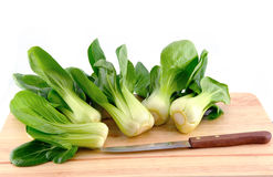Bok choy leaf on chopping board Royalty Free Stock Images