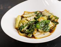 Bok choy vegetables stir fry with soy sauce and sesame seeds. Chinese cuisine stock images